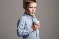 Happy child drinking milk little smiling boy enjoy milk cocktail healthy life Royalty Free Stock Photos