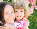 Happy child embraced your mother outdoors summer vacations Stock Photo