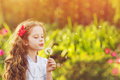 Happy child girl blowing dandelion Royalty Free Stock Photo