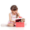 Happy child girl with cat in gift box Stock Photo