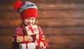 Happy child girl with Christmas present Royalty Free Stock Photo