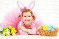 Happy child girl in costume Easter bunny rabbit with eggs and f Royalty Free Stock Photo
