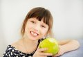 Happy child girl eating apple at home Royalty Free Stock Photo