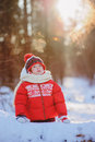 Happy child girl with frozen breath on the walk in snowy winter forest, outdoor activities on holidays Royalty Free Stock Photo