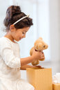 Happy child girl with gift box and teddy bear holidays presents christmas x mas birthday concept Royalty Free Stock Photography