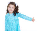 Happy child girl with hands thumbs up. Royalty Free Stock Photo