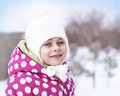 Happy child girl having fun in the snow - winter time Stock Photos