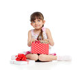 Happy child girl holding gift box with kitten Stock Photos