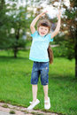 Happy child girl is jumping in the air outdoors Royalty Free Stock Photography