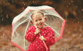 Happy child girl laughing with an umbrella in rain Royalty Free Stock Photo