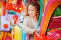 Happy child girl riding train on funfair on summer vacation Royalty Free Stock Photo