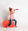 Happy child girl with spyglass, explore and adventure concept Royalty Free Stock Photo