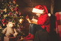Happy child girl writes letter to Santa Claus at the Christmas t Royalty Free Stock Photo