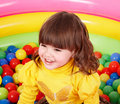 Happy child in group colorful ball. Stock Photos