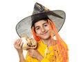 Happy child in halloween outfit with jack o lantern pumpkin on shoulder isolated on white Royalty Free Stock Photography