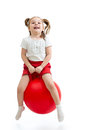 Happy child jumping on bouncing ball kid Stock Image