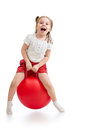Happy child jumping on bouncing ball white background Stock Image