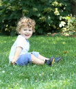 Happy child laughing outdoors summer in grass Stock Photography