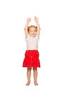 Happy child lifting up her hands. Stock Photo