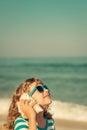 Happy child listen seashell on the beach Royalty Free Stock Photo