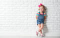 Happy child little girl laughing at blank brick wall Royalty Free Stock Photo