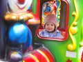 Happy child at merry-go-round Royalty Free Stock Photo