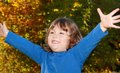 Happy child in nature during fall Royalty Free Stock Photo