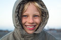 Happy child outdoors in warm jacket Royalty Free Stock Photo