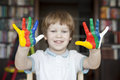 Happy child with painted hands Stock Images