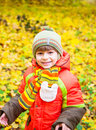 Happy child playing in autumn park Stock Image