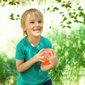 Happy child playing with ball outdoors. Little boy catching a small ball. Healthy and happy childhood. Funny child outdoors. Kids Royalty Free Stock Photo