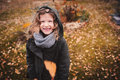 Happy child playing with leaves in autumn. Seasonal outdoor activities with kids