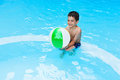 Happy child playing in pool during summer vacation Royalty Free Stock Image