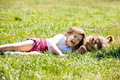 Happy child playing with puppy at meadow in summer three year old grass Stock Photo