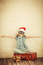 Happy child playing with toy airplane dressed in santa claus hat kid at home retro toned Stock Photos