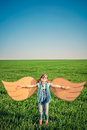 Happy child playing with toy paper wings Royalty Free Stock Photo