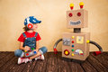 Happy child playing with toy robot Royalty Free Stock Photo