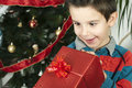 Happy child receive the gift of Christmas Stock Photo