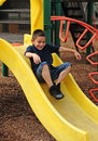 Happy child and slide Royalty Free Stock Photo