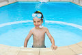 Happy child snorkeler in pool smiling wearing goggles and snorkel Stock Images