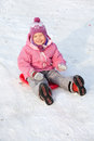 Happy child in snow Stock Images
