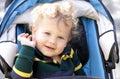 Happy Child in Stroller Stock Image