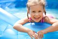 Happy child swimming portrait of cute little girl in pool outdoors Royalty Free Stock Photos