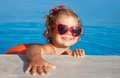 Happy child swimming portrait of cute little girl in pool outdoors Royalty Free Stock Photography