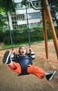 Happy child swinging Stock Photos