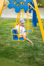 Happy child swinging on a swing Royalty Free Stock Photo
