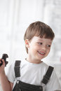 Happy child with tool indoors Stock Photo