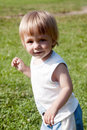 Happy child walking across meadow Royalty Free Stock Photo