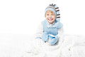 Happy child in warm winter clothes holding mug Royalty Free Stock Image