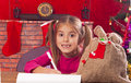 Happy child writes letter to Santa Claus Stock Image